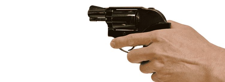 index finger in front of trigger guard